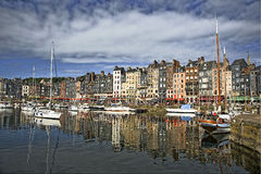 Honfleur harbor in France. Scenic view of boats moored in Honfleur harbor, Normandy, France Stock Photo