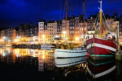 Honfleur harbor at night with boats, France royalty free stock photos