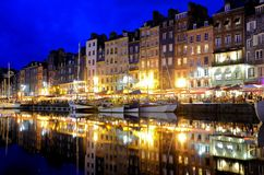 Honfleur harbor at night with reflections, France stock photos