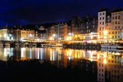 Honfleur harbor at night with reflections, France royalty free stock photos