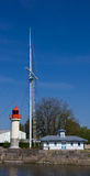 Honfleur harbour lighthouse. On of the lighthouses of the Honfleur old harbour and a symbolic mast placed on the ground Stock Images