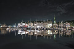 Honfleur night. Skyline port and water reflection. Stock Image