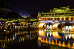 Hong Bridge at night in Fenghuang Ancient town, Hunan province. China. This ancient town was added to the UNESCO World Heritage Tentative List in the Cultural Stock Images