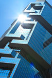 Hong Hong office building. Sunflare reflecting in the glass of skyscraper royalty free stock image
