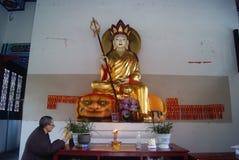 Hong Jiang, China: in the temple chanting old nun Royalty Free Stock Image