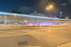 Hong knong  Long exposure captures light trails from passing and. KOWLOON, HONG KONG - SEPTEMBER 18 2017; Long exposure captures long horizontal light trails Royalty Free Stock Images