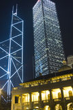 Hong Kong. It is night scene of two skyscrapers behind a English building in Hong Kong Royalty Free Stock Photo