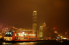 Hong Kong. Ferry vs Hong Kong night skyline - taken from Avenue of Stars stock photo