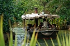 Hong Kong: African Safari Disneyland Boat Ride. Visitors to the Disneyland theme park in Hong Kong taking the African safari boat ride in Adventureland glide stock photos