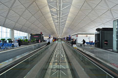 Hong Kong Airport. Passengers in the airport main lobby on November 16, 2013 in Hong Kong. This is the main airport of Hong Kong and is also known colloquially royalty free stock image