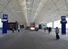 Hong Kong Airport. Passengers in the airport main lobby on November 16, 2013 in Hong Kong. This is the main airport of Hong Kong and is also known colloquially stock photos