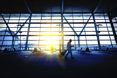 Hong Kong airport, travelers. Passengers walking in the airport departure lounge stock photo