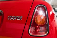 Hong Kong, Hong Kong - 25 April 2018: Close-up of Mini Cooper logo badge, taillights and details on the rear of a red Mini Cooper.  Royalty Free Stock Image