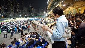 Hong Kong - April 2016: Hong Kong, Crowd and people gathering for gamble betting in Happy Valley horse racecourse, stock images