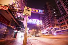 Night street and advertising neon lights in Kowloon district, Hong Kong Royalty Free Stock Photos
