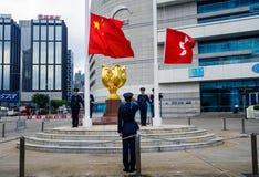 Hong Kong - August 9, 2018: Soldiers rising China and Hong Kong. Hong Kong - August 9, 2018: Soldiers performing China and Hong Kong flag rising ceremony at the stock image