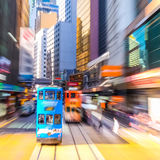 Hong Kong. Blurred cityscape view with blue tramway Royalty Free Stock Photos