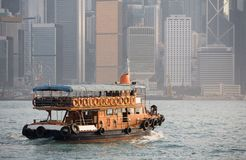 Hong Kong Boat. A boat travels across the harbour and heads toward Hong Kong island Royalty Free Stock Photos