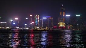 Hong Kong boats. Hong Kong, China - January 1, 2016: Hong Kong night skyline and boats from Kowloon with the landmarks of Bank of China Tower, HSBC Building, Two stock footage