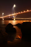 Hong Kong Bridge at night. Ting Kau Bridge night view with rocks royalty free stock images