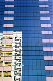 Hong Kong buildings. A residential apartment block mirrored in a highrise commercial office building in Wanchai, Hong Kong stock photography