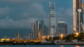 Hong Kong business center day to night timelapse with a cloudy blue sky before sunset stock video footage