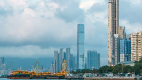 Hong Kong business center timelapse with a cloudy blue sky before sunset stock footage