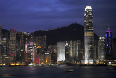 Hong Kong - Business District. The night skyline of the business district and Victoria Peak on Hong Kong Island. Viewed from across the harbor in Kowloon Stock Photography