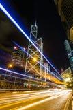 Hong Kong Business District en la noche con la pista ligera Foto de archivo libre de regalías