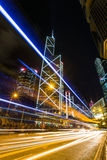 Hong Kong Business District at Night with Light Track Royalty Free Stock Photo