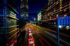 Hong Kong Business District at Night with Light Track royalty free stock photography