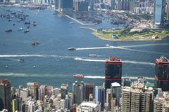 Hong Kong busy view. View over Hong Kong from Victoria peak showing a modern asian city with skyscrapers and harbour stock image