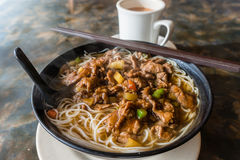 Hong Kong Cafe Style Satay Beef Rice Noodles. Satay beef soup noodles is featured in many Hong Kong cafes. Typically served with milk tea, the local dish is a Royalty Free Stock Photo