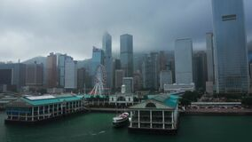 Hong Kong - 2020: Central Ferry Pier from above, city in the fog