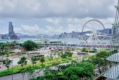 Hong Kong Central Pier and Hong Kong Observation Wheel stock photography
