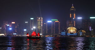 Hong Kong Central Plaza. Hong Kong, China - December 8, 2016: City skyline light show with Aqua Luna red-sail junk boats. Famous Central Plaza skyscraper and stock video footage