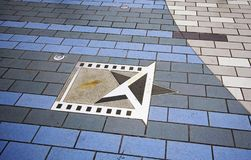 Hong Kong, China, actor Bruce Lee star on the waterfront. Avenue of Stars is a pedestrian zone of the waterfront of Victoria Bay in Hong Kong. This alley was stock image