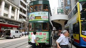 Hong Kong, China - August 15, 2018 : Busy pedestrian crossing and tram arrival at station