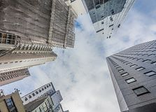 HONG KONG / CHINA-AUGUST 4 2017: Looking up to the sky in Hong Kong. The tall buildings can not be avoided and can be seen royalty free stock photos