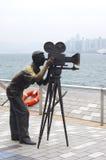 Estátua e skyline na avenida das estrelas, Hong Kong Foto de Stock Royalty Free