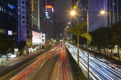 HONG KONG, CHINA - December 12: Car light trails scene at night on Gloucester Road in Wan Chai Disctrict, Hong Kong, China. Stock Photography