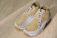 Hong Kong, China - 27 December, 2017: Nike Air Footscape Woven Chukka QS Hairy Suede on a wooden surface.  Royalty Free Stock Photography