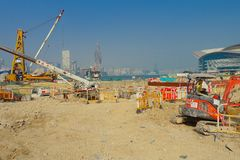 HONG KONG, CHINA - JANUARY 26, 2017:Construction site of pier, with different machines in a sunny day, in Hong Kong Royalty Free Stock Image
