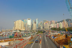 HONG KONG, CHINA - JANUARY 26, 2017: Construction site of pier, witrh some cars in a road with a city in the horizont in. Hong Kong, China stock photography