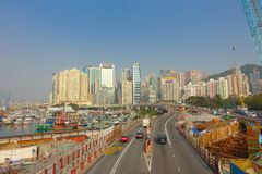 HONG KONG, CHINA - JANUARY 26, 2017: Construction site of pier, witrh some cars in a road with a city in the horizont in. Hong Kong, China stock photos