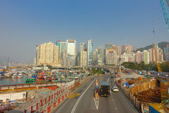 HONG KONG, CHINA - JANUARY 26, 2017: Construction site of pier, witrh some cars in a road with a city in the horizont in. Hong Kong, China stock images
