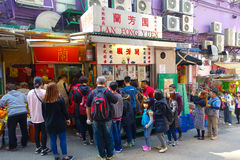 HONG KONG, CHINA - JANUARY 26, 2017: Crowd of people buying food in the Street stand in the city of Hong Kong Royalty Free Stock Image