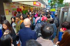 HONG KONG, CHINA - JANUARY 26, 2017: Crowd of tourists walking near to Victoria park in Hong Kong, China Stock Photos