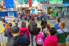 HONG KONG, CHINA - JANUARY 26, 2017: Crowd of tourists walking near to Victoria park in Hong Kong, China Stock Image