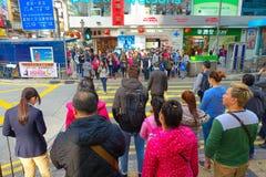 HONG KONG, CHINA - JANUARY 26, 2017: Crowd of tourists walking near to Victoria park in Hong Kong, China Royalty Free Stock Photography